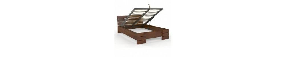 Łóżka drewniane ze skrzynią na pościel