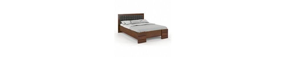 Łóżka drewniane z tapicerowanym zagłówkiem